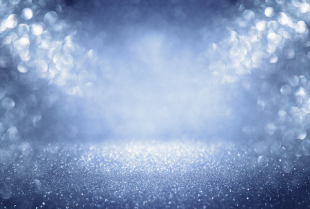 Foto de glitter vintage lights background. silver, blue and white. defocused. - Imagen libre de derechos