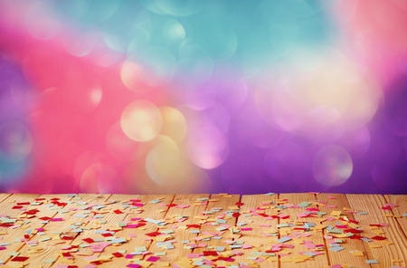 Photo for pink party whistle on wooden table with colorful confetti. vintage filtered image - Royalty Free Image
