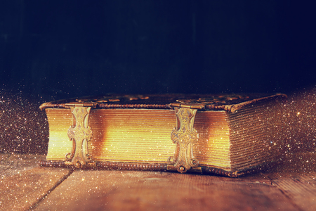 Photo for low key image of antique story book. vintage filtered with glitter overlay. selective focus - Royalty Free Image