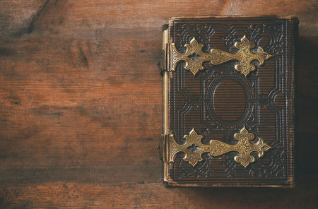 Photo for top view of antique book cover, with brass clasps. vintage filtered - Royalty Free Image