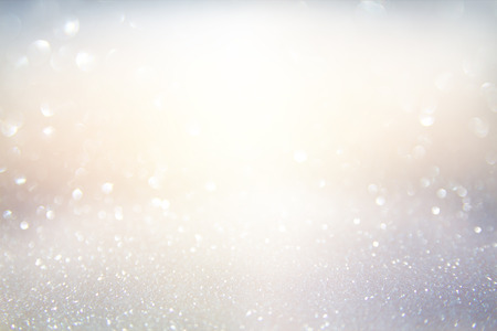Foto de glitter vintage lights background. gold, silver, blue and white. de-focused. - Imagen libre de derechos