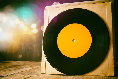 Photo pour close up of old records on wooden table with glitter background. room for text - image libre de droit