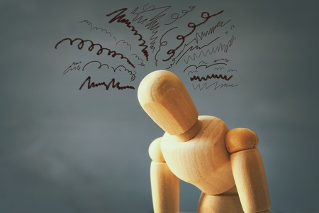 Foto de image of wooden dummy with worried stressed thoughts. depression, obsessive compulsive, adhd, anxiety disorders concept - Imagen libre de derechos