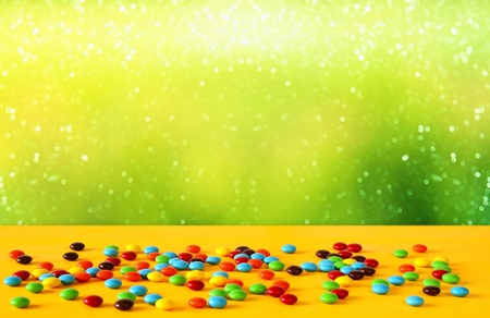 Photo for Party table with candies in front of glitter background. - Royalty Free Image