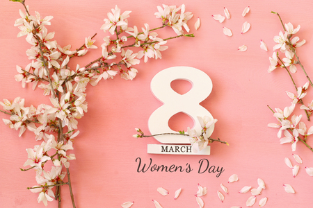Photo for International women day concept. Cherry tree and date. Top view image - Royalty Free Image