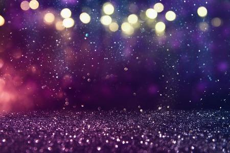 Foto de glitter vintage lights background. gold, purple and black. de-focused. - Imagen libre de derechos