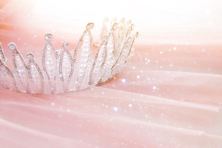 Photo for Vintage tulle pink chiffon dress and diamond tiara on wooden white table. Wedding and girl's party concept. - Royalty Free Image