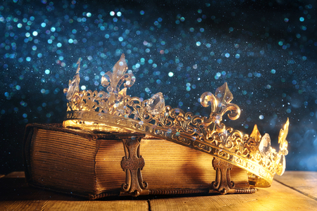 Foto de low key image of beautiful queen/king crown on old book. vintage filtered. fantasy medieval period - Imagen libre de derechos