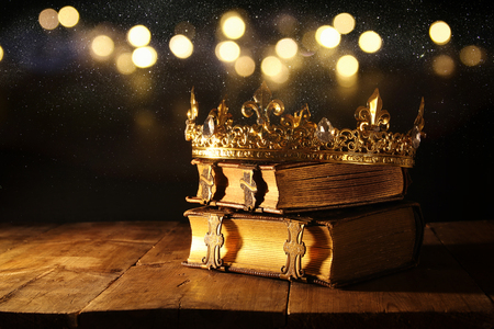 Photo for low key image of beautiful queen/king crown on old books. vintage filtered. fantasy medieval period - Royalty Free Image