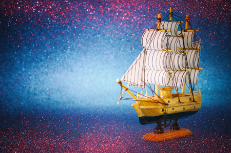 Foto de Columbus day concept with old ship over blue glitter background. - Imagen libre de derechos