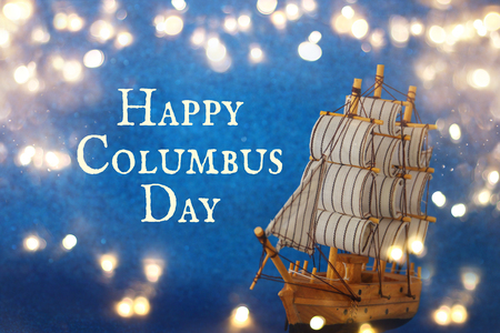 Photo for Columbus day concept with old ship over blue glitter background. - Royalty Free Image