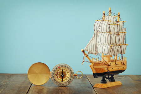 Foto de Columbus day concept with old ship over wooden background. - Imagen libre de derechos