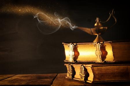 Foto de Image of magical aladdin lamp with glitter smoke. Lamp of wishes - Imagen libre de derechos