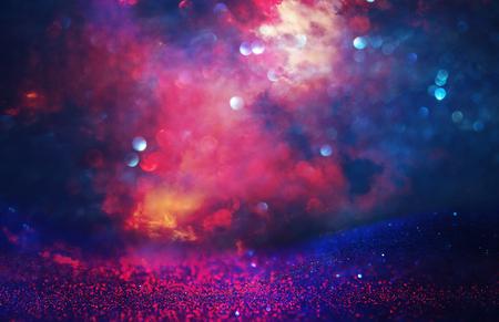Foto de Purple and red glitter lights background. defocused - Imagen libre de derechos