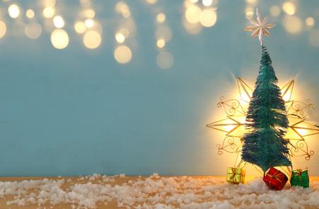 Foto de Image of christmas trees on snowy wooden table - Imagen libre de derechos