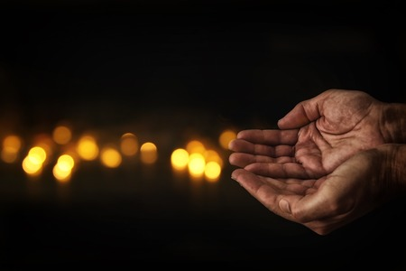 Photo for closeup hands of elderly man begging for help. concept for poverty or hunger or seeking for light in the dark - Royalty Free Image