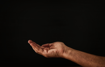 Photo for image of open male hand begging for help - Royalty Free Image