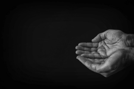 Photo for black and white image of open male hand begging for help - Royalty Free Image
