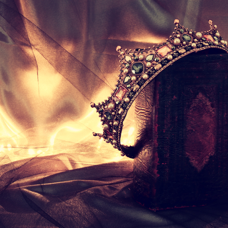 Photo for low key image of beautiful queen/king crown on old book. fantasy medieval period - Royalty Free Image