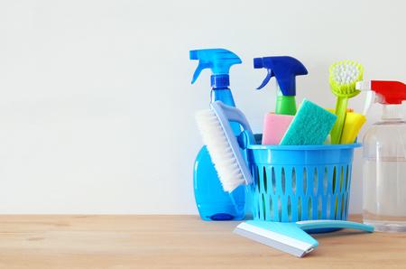Foto de Spring cleaning concept with supplies on wooden table - Imagen libre de derechos