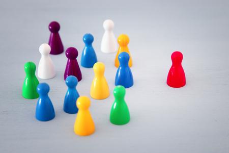 Photo pour image of colorful game figures over wooden table ,human resources and management concept - image libre de droit