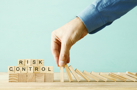 Photo for image of male hand stopping the domino effect. executive and risk control concept - Royalty Free Image