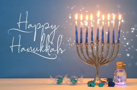 Photo for image of jewish holiday Hanukkah background with menorah (traditional candelabra) and candles - Royalty Free Image