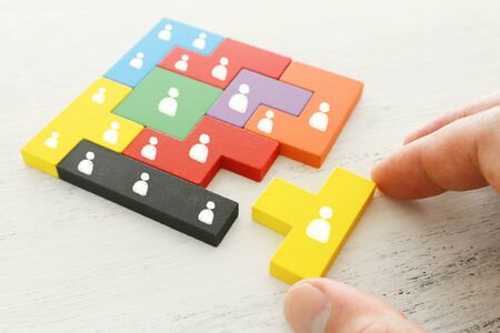 Foto de business concept image of tangram puzzle blocks with people icons over wooden table ,human resources and management concept - Imagen libre de derechos