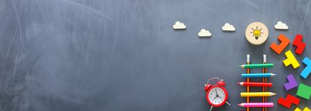 Photo for Education concept of Ladder made from pencils next to clouds over blackboard - Royalty Free Image
