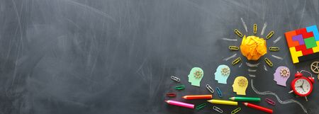 Photo pour Education concept image. Creative idea and innovation. Crumpled paper as light bulb metaphor over blackboard - image libre de droit