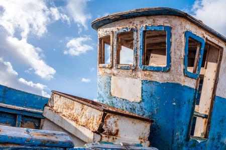 Foto de Old wooden blue ship wreck, with wheelhouse without windows - Imagen libre de derechos