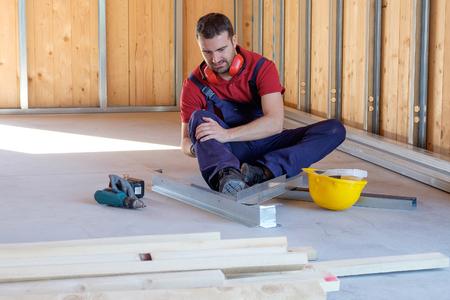 Foto de Worker suffering after  on-the-job injury - Imagen libre de derechos