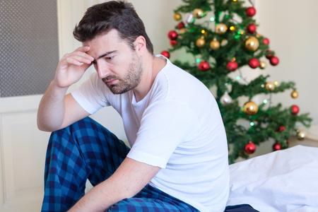 Foto de Man lying in bed with negative feelings and emotions - Imagen libre de derechos