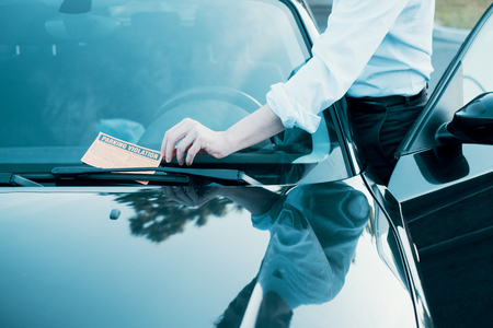 Photo pour  Ticket fine because of parking violation on the windshield - image libre de droit