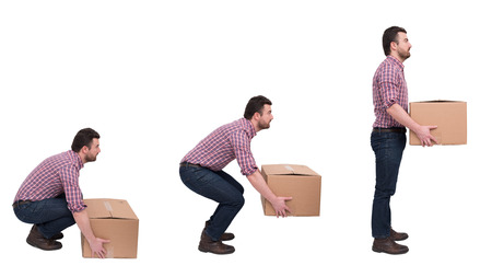 Foto de Proper heavy weight boxes lifting against backache - Imagen libre de derechos