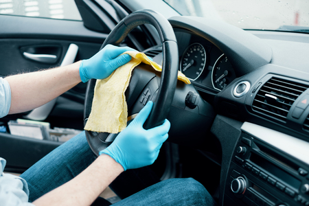 Photo for Man cleaning his car interiors and wheel - Royalty Free Image
