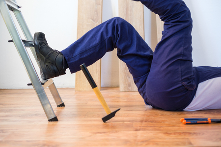 Photo pour On the job injury of one worker just fallen from a ladder - image libre de droit