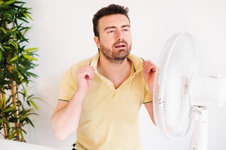 Photo pour Young man sweating because summer heat haze - image libre de droit