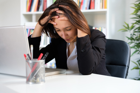 Photo pour Overworked woman feeling exhausted because of too many job hours - image libre de droit