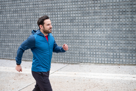 Foto per Urban runner doing training session in the street c - Immagine Royalty Free
