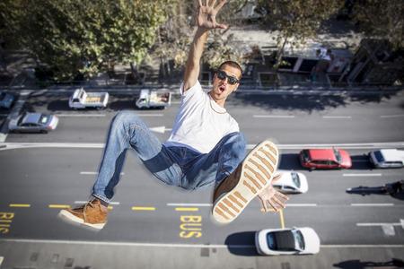 Foto de young man falling down of a building - Imagen libre de derechos