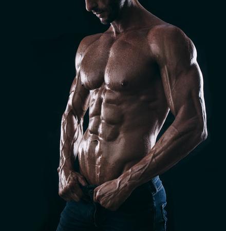 Foto de muscle man torso on black background, bodybuilding athlete portrait - Imagen libre de derechos