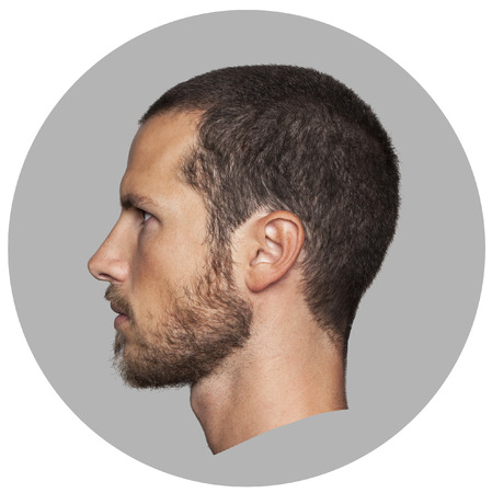 Foto de coin like portrait of an handsome young man profile - Imagen libre de derechos