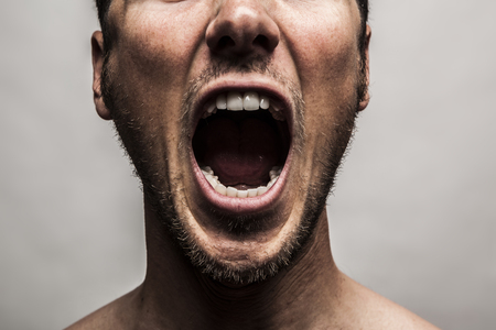 Photo for close up portrait of a man shouting, mouth wide open - Royalty Free Image