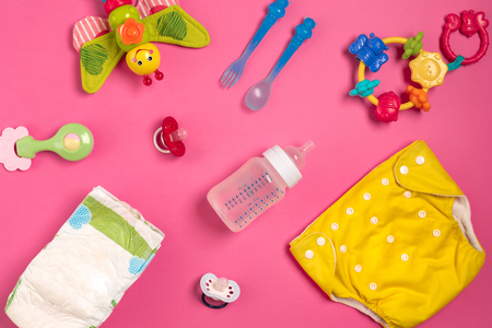 Photo pour Baby care accessories and diapers on pink background. Top view - image libre de droit