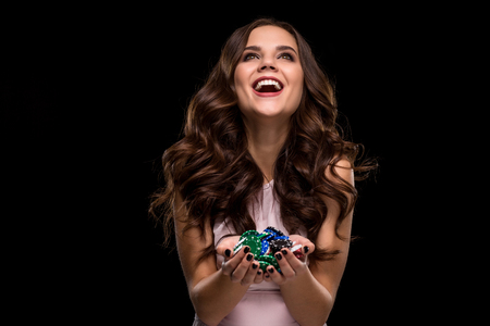 Foto de Female Poker player with paint black nails hold her poker chips to make a bet. Gambling and casino business concept - Imagen libre de derechos