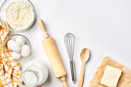 Photo for Preparation of the dough. A measurement of the amount of ingredients in the recipe. Ingredients for the dough: flour, eggs, rolling pin, whisk, milk, butter, cream. Top view, space for text - Royalty Free Image