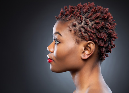 Black beauty with short spiky red hair