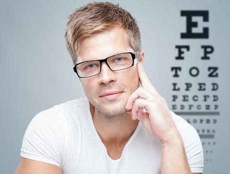 Photo pour Handsome young man wearing glasses - image libre de droit