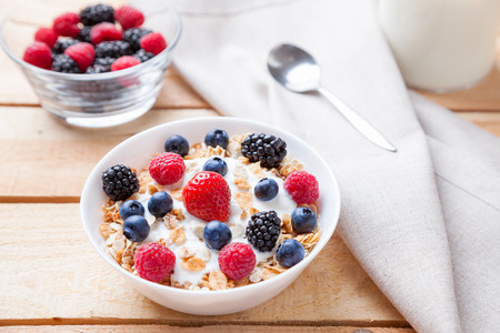 Photo for Healthy and nutritious bio yogurt with cereal and fresh raw berries - Royalty Free Image